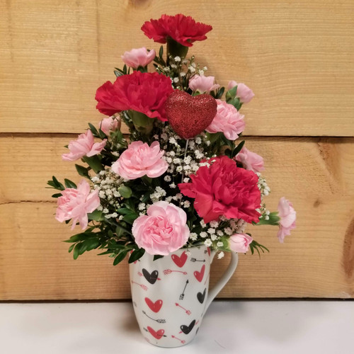 Red Carnation Love Mug (SCF19V05) by Savilles Country Florist.  Flower and Plant delivery to Orchard Park, NY and the surrounding area including same day delivery to Hamburg, West Seneca, East Aurora, Blasdell and Buffalo NY