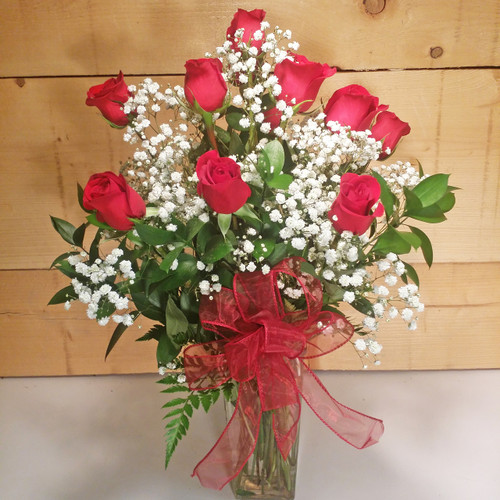 Red Roses Vased Bouquet by Savilles Country Florist. Flower delivery to Orchard Park, Hamburg, West Seneca, East Aurora, Buffalo, NY and surrounding suburbs.