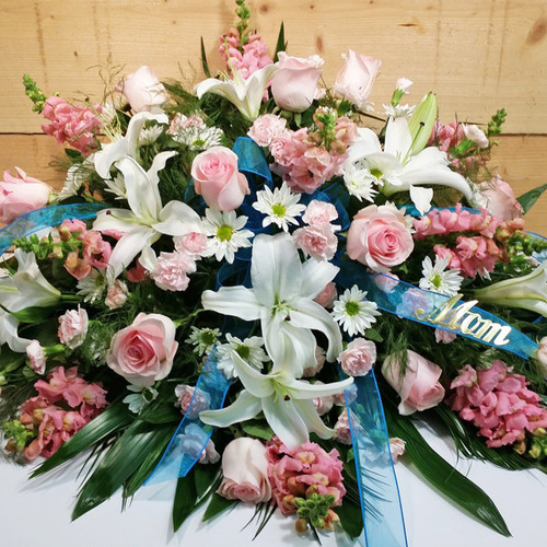 Eternal Love Half Casket Spray (SCF1102) by Savilles Country Florist.  Flower and Plant delivery to Orchard Park, NY and the surrounding area including same day delivery to Hamburg, West Seneca, East Aurora, Blasdell and Buffalo NY