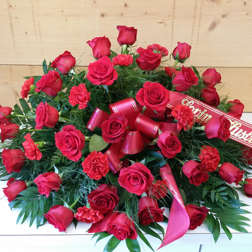 Red Roses & Carnation Casket Spray (SCF1162) by Savilles Country Florist.  Flower and Plant delivery to Orchard Park, NY and the surrounding area including same day delivery to Hamburg, West Seneca, East Aurora, Blasdell and Buffalo NY