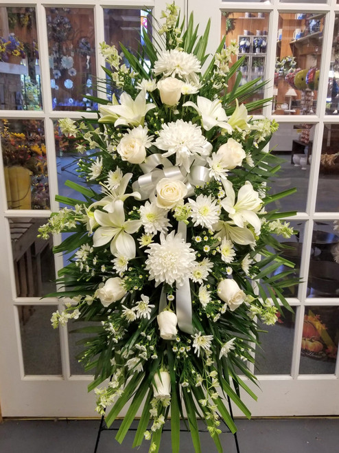 White Sympathy Standing Spray by Savilles Country Florist. Flower delivery to Orchard Park, Hamburg, West Seneca, East Aurora, Buffalo, NY and surrounding suburbs.