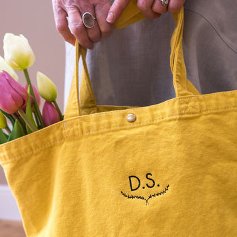 a personalised embroidered colourful bag