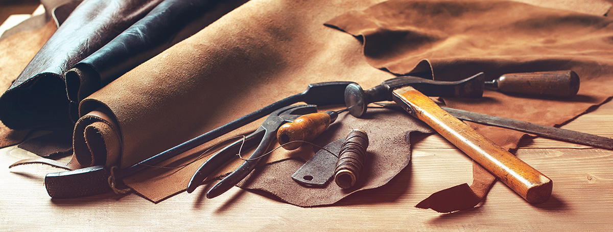 workboot-technology-page-workbench-leather-material-2-and-leather-working-tools-for-making-work-boots.jpg