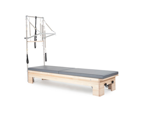 studio reformer with tower and mat for pilates and functional training handmade by balanced body usa