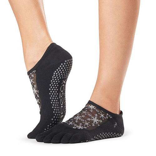 black pilates socks with white snowflakes