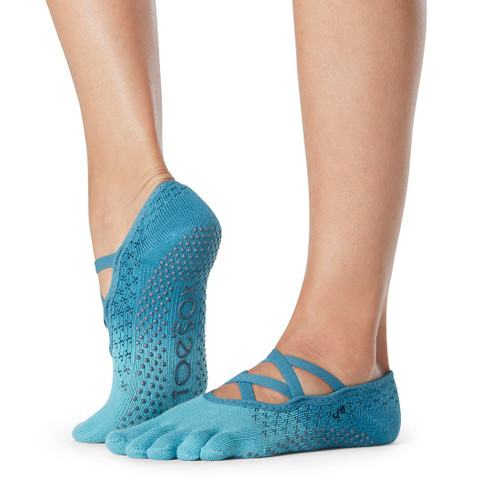turquoise socks for pilates and yoga with x cut design on top