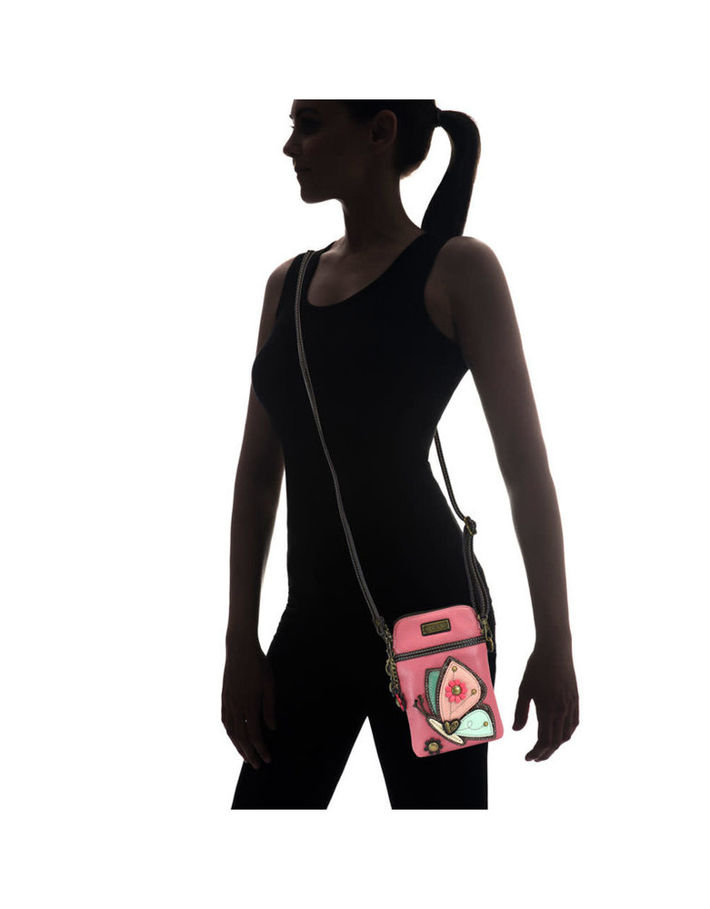 This images shows relative size of the Cell Phone Xbody Purse. The color and design is not accurate for the unicorn model.