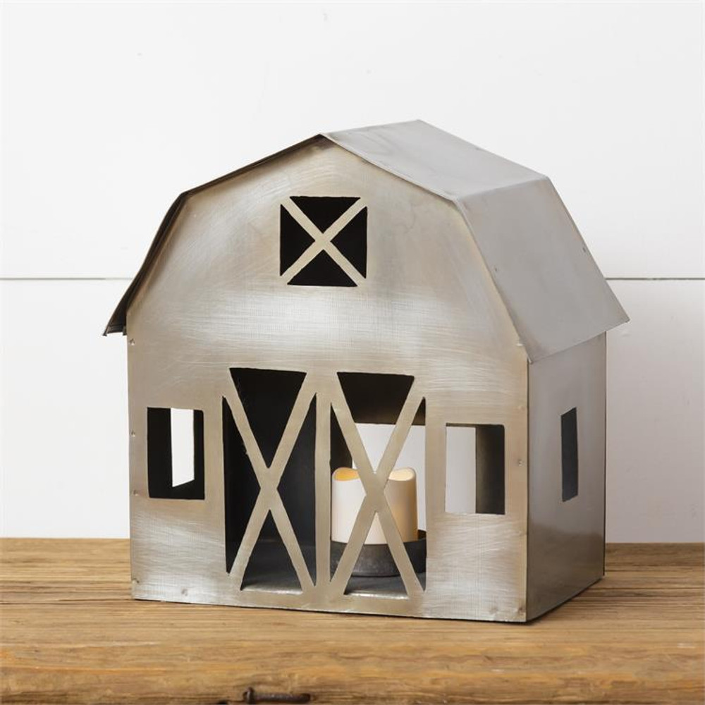 Candle holder in barn shape made of iron