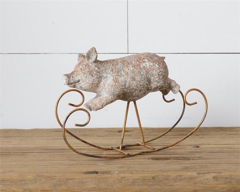 Rustic resin pig decor on rocking horse base,