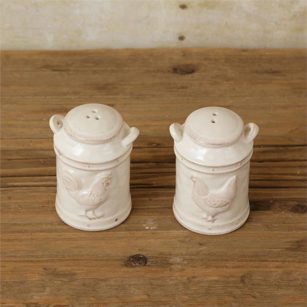 White salt and pepper shakers shaped like milk cans