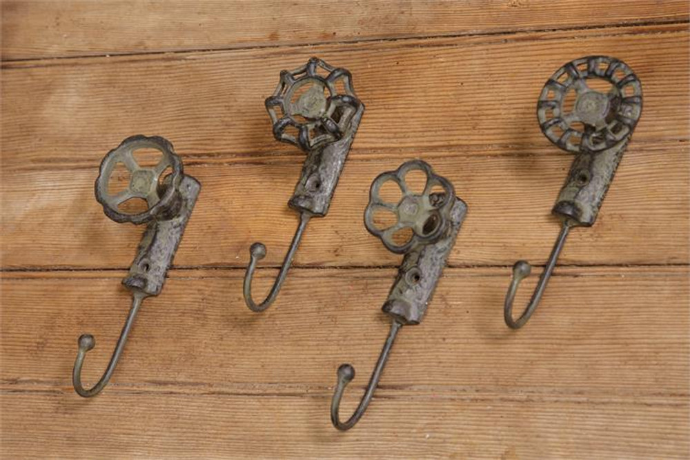 Set of 4 cast iron wall hooks that look like faucet handles