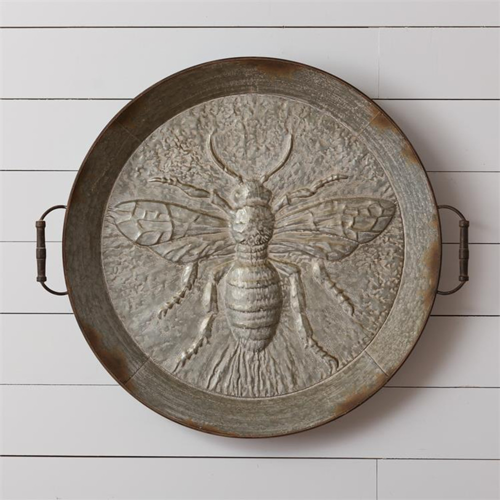 Antique looking iron tray deeply embossed with bee design
