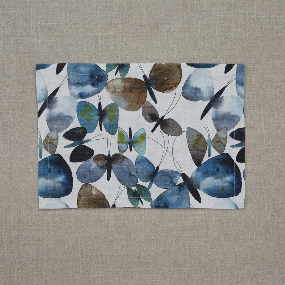 Cotton placemat printed with blue butterfly motif