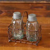 Salt and pepper shakers in caddy, shaped like mason jars