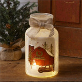 Frosted jar with lights to luminate a barn and Merry Christmas motif