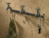 Triple hooks that look like water faucets for hanging, hangs on wall, one unit of 3 hooks