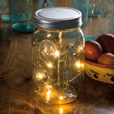 Large mouth mason jar with lights.  Has timer, needs batteries to light up