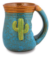 Stoneware coffee mug with cactus design in a hand warming style.