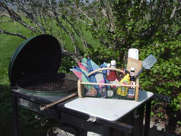 Garden Hod holding barbecue picnic supplies
