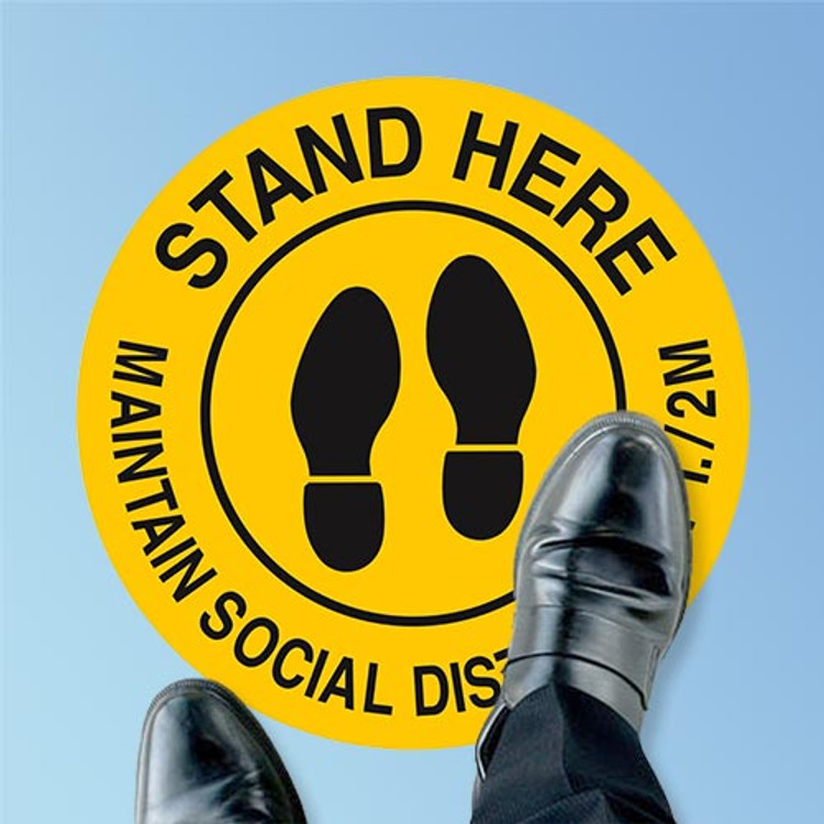 Brady Stand Here Social Distancing Circular Floor Sign, Black on Yellow, 17 inch (170215) at Harmony Lab and Safety Supplies