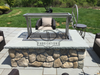 Stainless Santa Maria Argentine Grill with height adjustable rotisserie.
