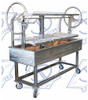 Portable all Stainless Argentine inspired Santa Maria Gaucho Grill. Whole animal rotisserie with top warming rack. Available with Stainless Argentinian V-Grates or Stainless Free Float Round Rod Grates.