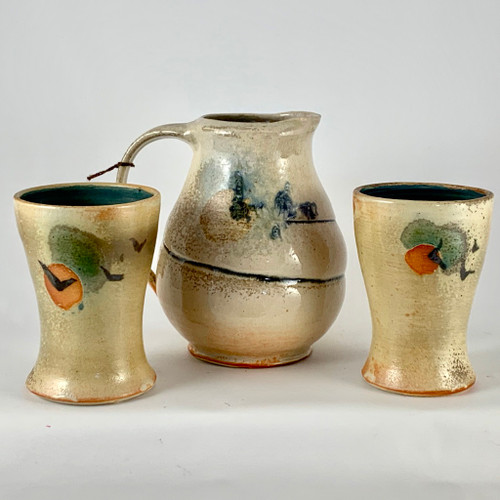 Stunning handmade Pitcher and Tumblers by Phoenix Pottery. These unique one of a kind pieces are special. The hand painted bird over the sun is wonderful. The pitcher and tumblers are functional as well as decorative.  The tumblers are pretty themselves and you can enjoy a nice cold drink like ice tea!