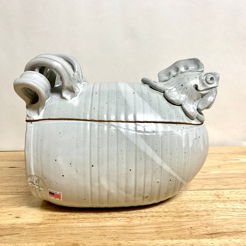 Handmade Chicken Cooker. This signature piece has been around for 35 years. It comes in a nice white glaze and measures 8 1/2 '' long 7 1/2'' high 6'' wide.  Non-lead glaze. Dishwasher safe
