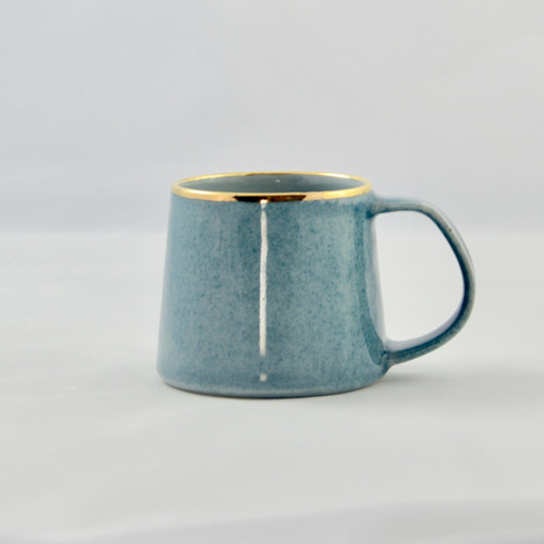 Very sweet and petite blue speckled mug. .The mug features a base white glaze with blue speckles and is further highlighted by a rim of 22k gold luster.