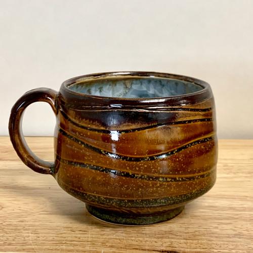 Handmade Crystalline Mug. Chocolate exterior and Green Crystals interior