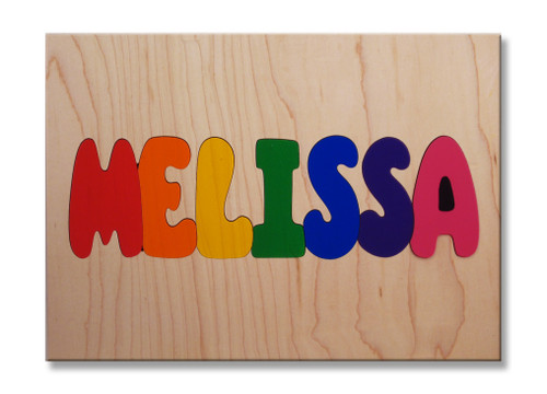 Wooden One Name Puzzle with all capital letters on a natural background.