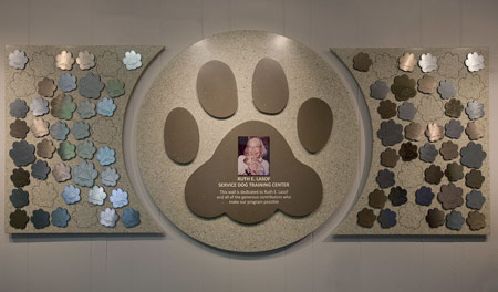 Donors and level of giving are recognized with laser-cut dog paws, in colors of gold, silver and bronze, along with a large, engraved and color-filled paw in the center that includes a sublimated photograph.