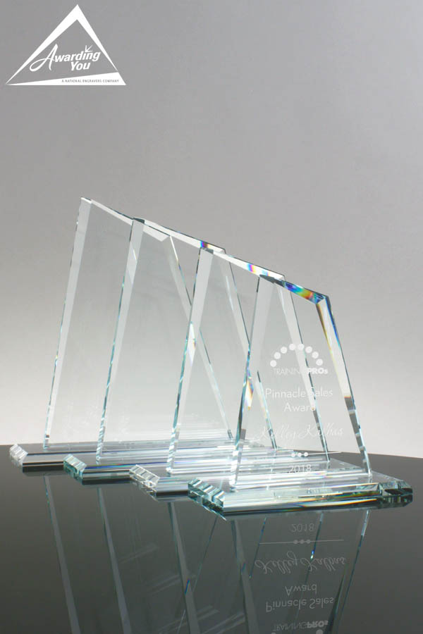 Nominees are often recognized with engraved glass awards