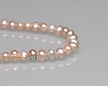"Near Round Peach Freshwater Pearls 5-6mm | Sold By 1 Strand(7"") 