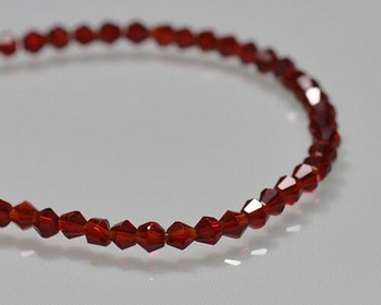 """Faceted Bicone Siam Crystal Beads 3x3.5  