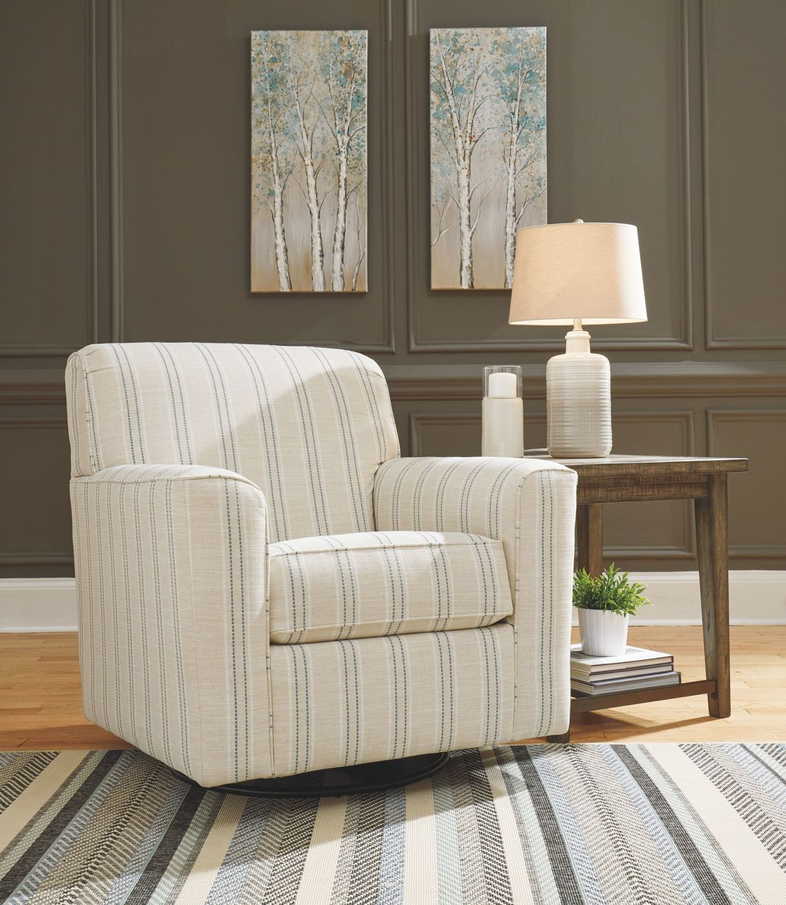 The Alandari Gray Swivel Glider Accent Chair Available At Dayton