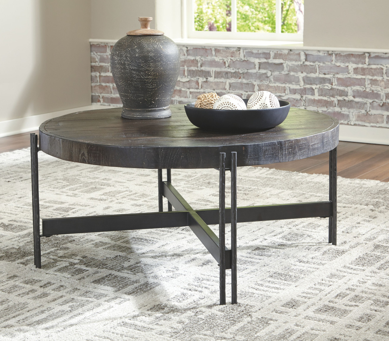 The Jillenhurst Dark Brown Round Cocktail Table Available At Dayton Discount Furniture Serving Vandalia Kettering And Springfield Ohio [ 1122 x 1280 Pixel ]