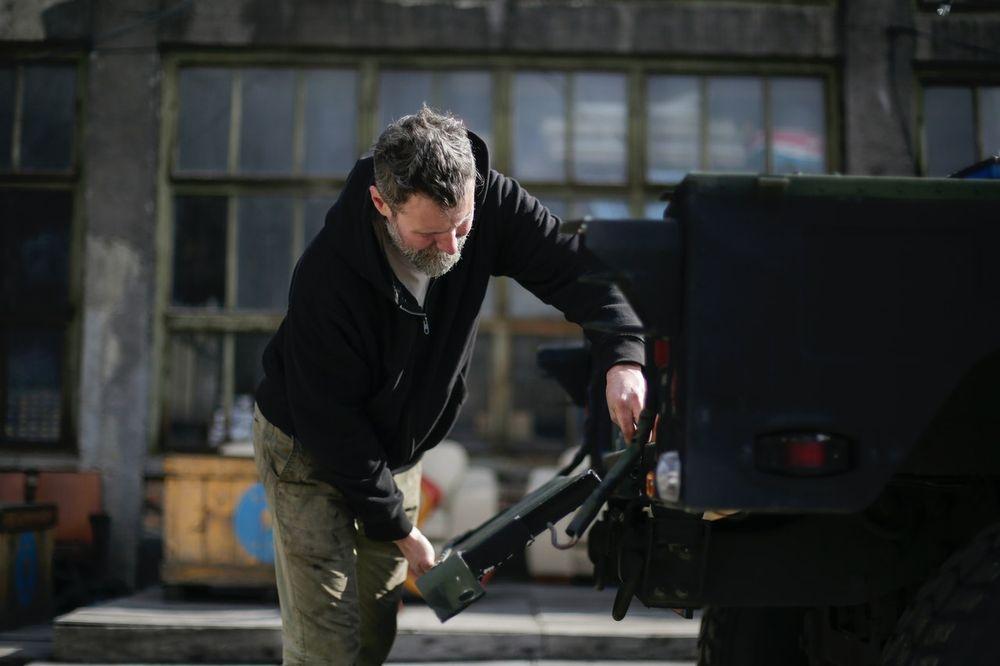 A man repairing a truck tailgate