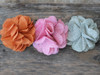 Derby Linen flower for dog collars shown in melon orange, cherry blossom pink and smoke grey by www.diva-dog.com