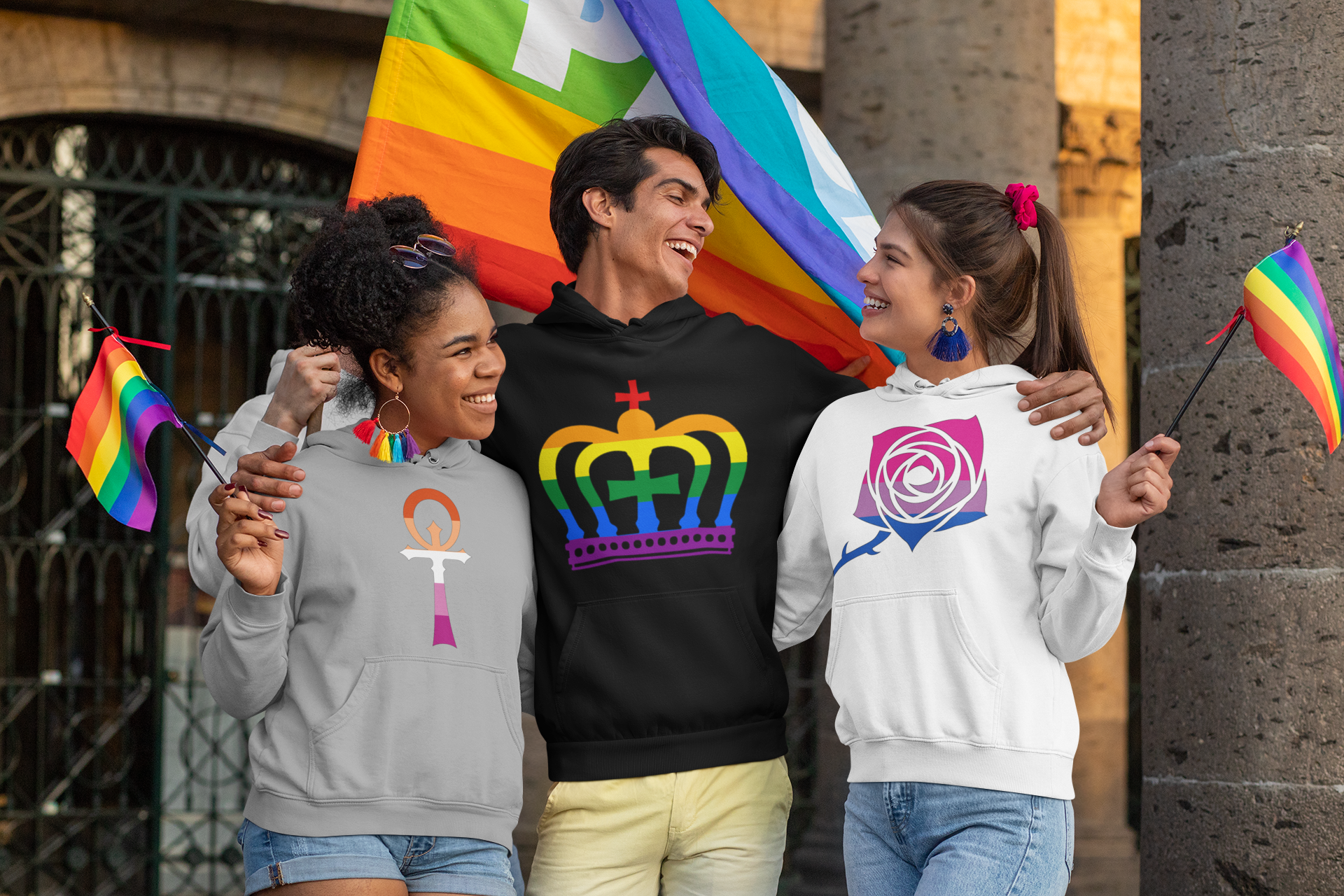 pullover-hoodie-mockup-of-three-happy-friends-holding-lgbt-pride-flags-33006.png