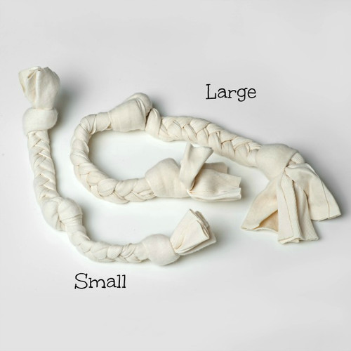 Image showing our small dog tug toy next to our large organic cotton tug toy.  Small tug is now made with natural white cotton only.