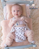 White with black spots nappy cover and pink legwarmers.