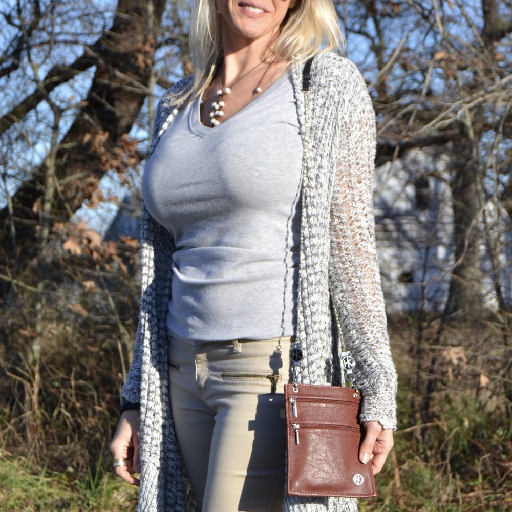 "Shoulder Strap: This strap can be used as a shoulder strap with a variety of lengths; 43""-52"". (The Hip Klips add an additional 2"" to the length). Model is 5'6"" and has the strap extended to 45""."