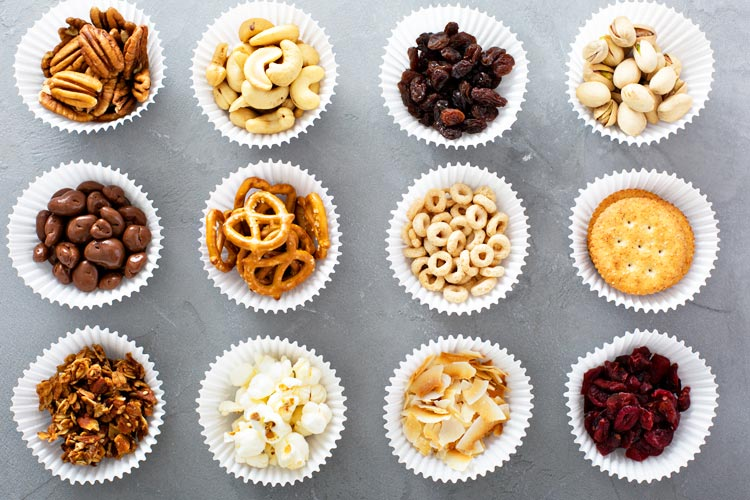 Healthy Snack Options in Cupcake Liners for your carnival - including nuts, cheerios, crackers, raisins, dried fruit, etc.