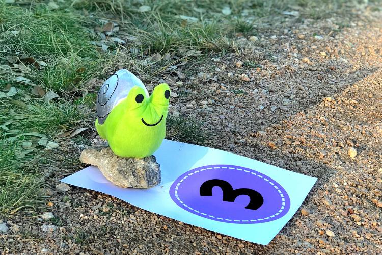 Stuffed animal snail on a walking trail