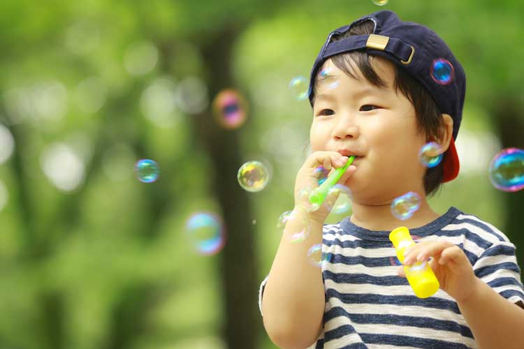 toddler-playing-with-toy-bubbles.jpg