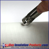 """Pipe Insulation Support Peg Install - Step 1, Cut out 3/4"""" round hole in pipe insulation at the location of the pipe hanger.  Photo Shows use of our Hole Carver Tool."""