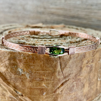 This IN STOCK Synthetic Peridot bracelet is shown in an all Rose Gold band but also offered in 9 different metal choices with two different designs and your custom size. Please place that order in the CUSTOM tab. Shown in an all rose gold classic band.