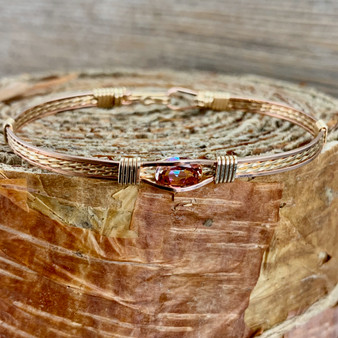 """This stunning gemstone is an Anastasia Topaz paired up with a yellow and rose gold classic bracelet band. We stock a true size 7"""" finished but occasionally offer this IN STOCK in additional sizes due to its popularity. Please message us if you are in a hurry for a special gift idea and we will be happy to check on additional items IN STOCK. The bracelet shown is IN STOCK currently in a 7"""" band."""