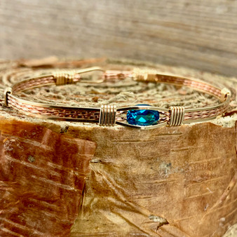 "This stunning gemstone is an soft Teal Green Topaz paired up with a yellow and rose gold classic bracelet band. We stock a true size 7"" finish. Please message us if you are in a hurry for a special gift idea and we will be happy to check on additional items IN STOCK. The bracelet shown is IN STOCK currently in a 7"" band."